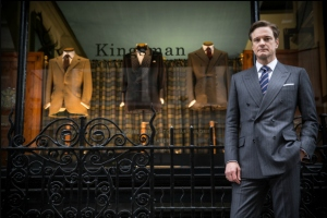kingsman colin in front of suit store